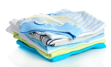 ironed: Pile of baby clothes isolated on white