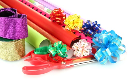Rolls of Christmas wrapping paper with ribbons, bows isolated on white 版權商用圖片