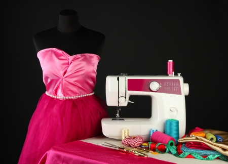 Sewing machine, dummy and other sewing equipment isolated on black Stock Photo - 18508587