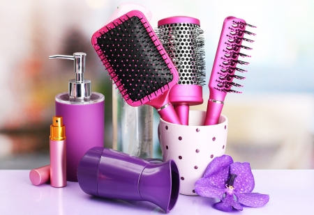 Hair brushes, hairdryer and cosmetic bottles in beauty salon Stock Photo - 18508679