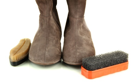 Brushes for suede shoes and female boots, isolated on white photo