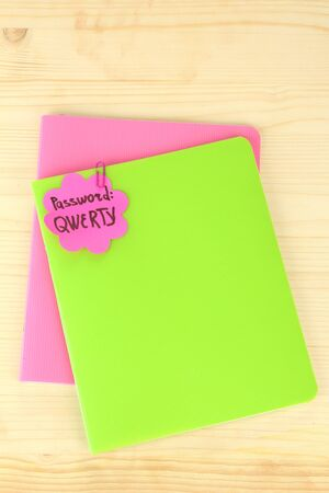 Sticker-reminder with most popular password, on notebook, on wooden background Stock Photo - 18508651