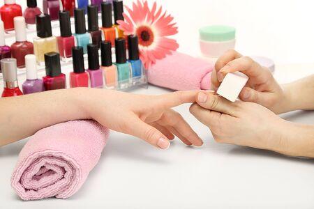 acrylic nails: Manicure process in beauty salon, close up