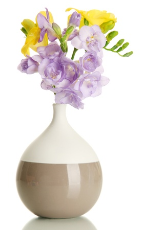 flower vase: Beautiful bouquet of freesias in vase, isolated on white