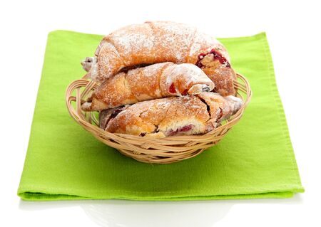 Taste croissants in basket isolated on white  photo