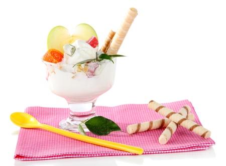 Ice cream with wafer sticks on napkin on white background Stock Photo