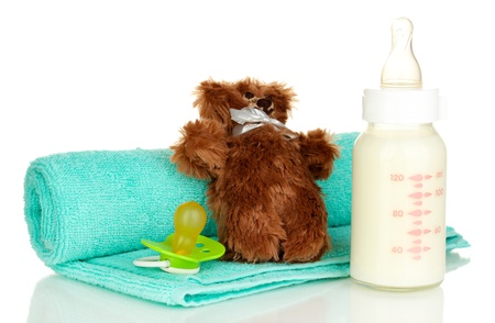 Baby bottle of milk with teddy bear  isolated on white Stock Photo - 18557834