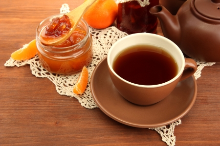light breakfast with tea and homemade jam, on wooden table Stock Photo - 18558911