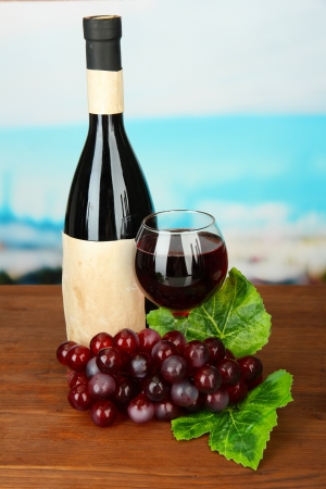 Composition of wine bottle, glass and  grape, on bright background Stock Photo - 18558549