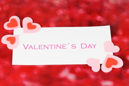 Greeting card for Valentines Day on red background photo