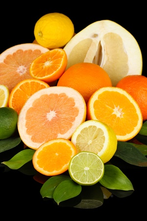 Lots ripe citrus isolated on black Stock Photo - 18557902