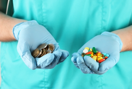 Doctor gives many different pills, on blue background photo