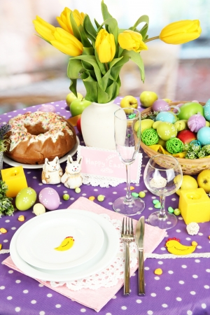 Serving Easter table on room background photo