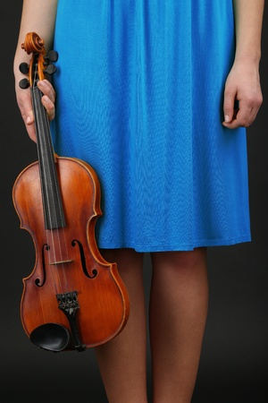 Young girl with violin on grey background Stock Photo - 18558982