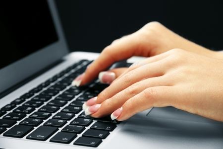 laptot: Female hands typing on laptot, close-up