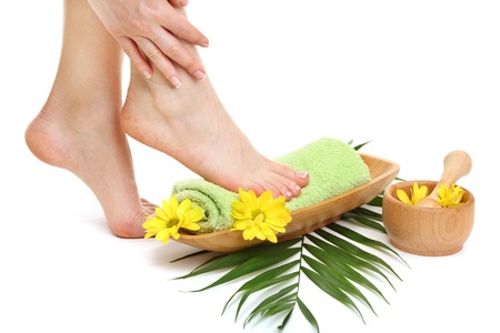 girl feet: Female feet with towel - spa concept, isolated on white