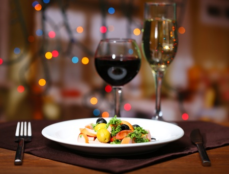 Tasty salad on dark background with bokeh  defocused lights photo
