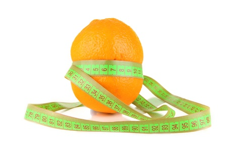 Orange with measuring tape, isolated on white photo