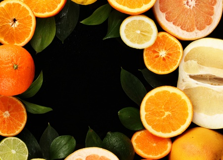 Lots ripe citrus isolated on black Stock Photo - 18609843