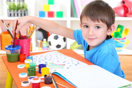 Cute little boy painting in his album Stock Photo