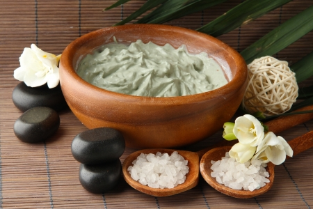 stone bowl: Composition with cosmetic clay for spa treatments, on bamboo background