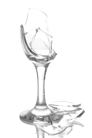 Broken champagne glass isolated on white photo