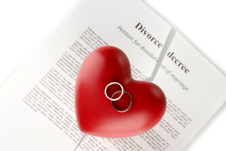 decree: red heart with torn Divorce decree document, on white background close-up