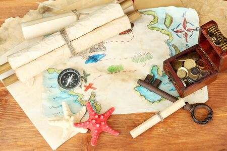 map of treasures on wooden background Stock Photo - 18643408