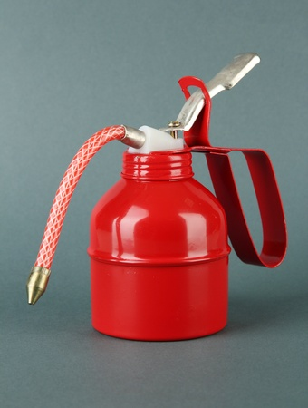 Red oil can, on color background Stock Photo - 18640450