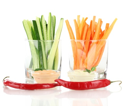 Assorted raw vegetables sticks isolated on white photo
