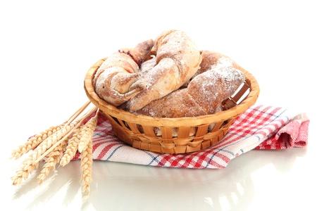 sugar powder: Taste croissants in basket isolated on white