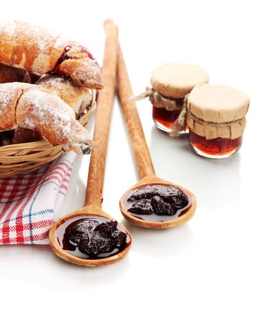 Taste croissants in basket and jam isolated on white Stock Photo - 18640165