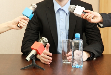 spokesman: Conference meeting microphone with businessman or politician Stock Photo
