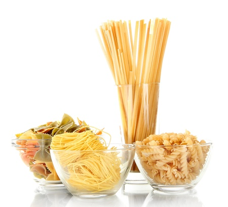 Different types of pasta isolated on white photo