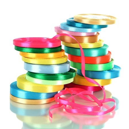 Many bright ribbons isolated on white photo