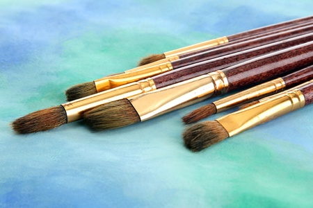 brushes on bright abstract gouache painted background Stock Photo - 18662858