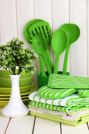 else: Kitchen settings: utensil, potholders, towels and else  on wooden table Stock Photo