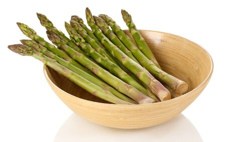 nutritiously: Fresh asparagus in wooden bowl isolated on white  Stock Photo
