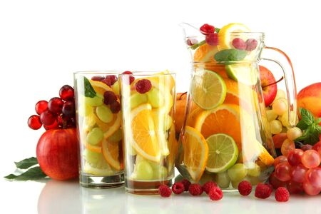 transparent jar and glasses with exotic  fruits, isolated on white Stock Photo - 18695686