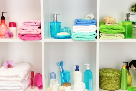 Bath accessories on shelfs in bathroom photo