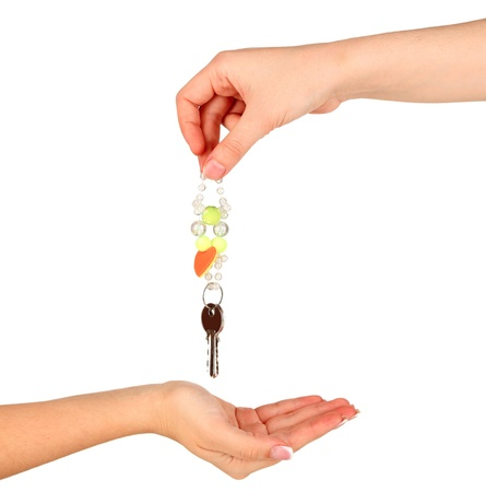 Transfer of house keys isolated on white photo