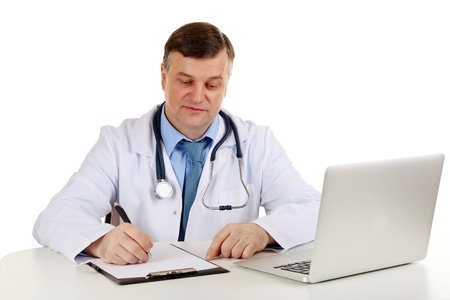 Medical doctor working at desk isolated on white photo