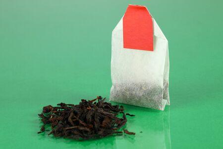 Tea bag on green background Stock Photo