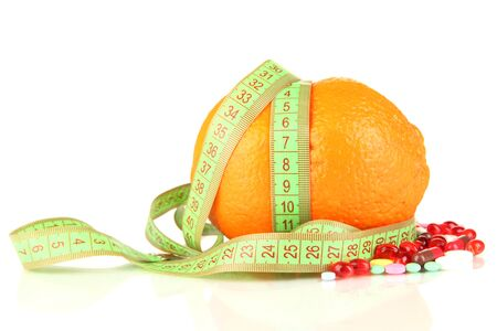Orange with measuring tape and multicolor pills, isolated white Stock Photo - 18693980