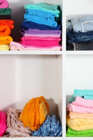 Clothes neatly folded on shelves Stock Photo - 18695799
