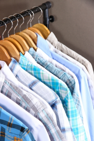 Mens shirts on hangers on gray background photo