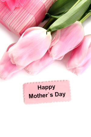 Beautiful bouquet of pink tulips and gift for Mother's Day, isolated on white photo