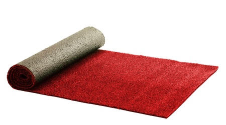 red carpet background: Artificial rolled red grass, isolated on white Stock Photo