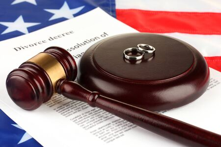 decree: Divorce decree and wooden gavel on american flag background