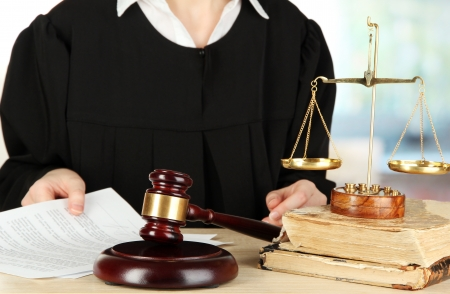 golden rule: Judge sitting at table during court hearings on room background Stock Photo